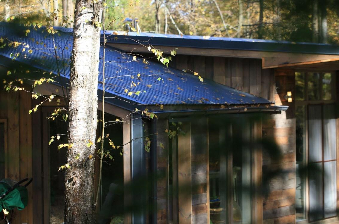 Dise o casa de campo moderna de madera construye hogar for La casa tiene un techo