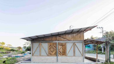 Photo of Diseño de pequeña casa de campo construida con bambú, concreto y ladrillo