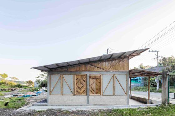 Casa de campo rústica con bambú, ladrillo y hormigón