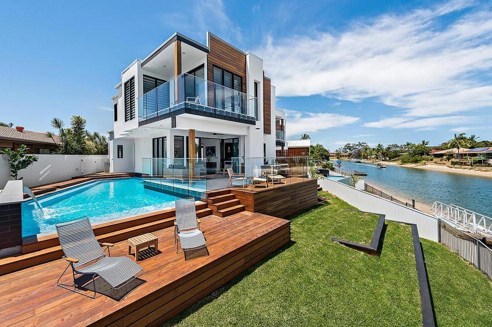 Dise o casa moderna dos pisos con piscina for Diseno de piscinas para casas de campo