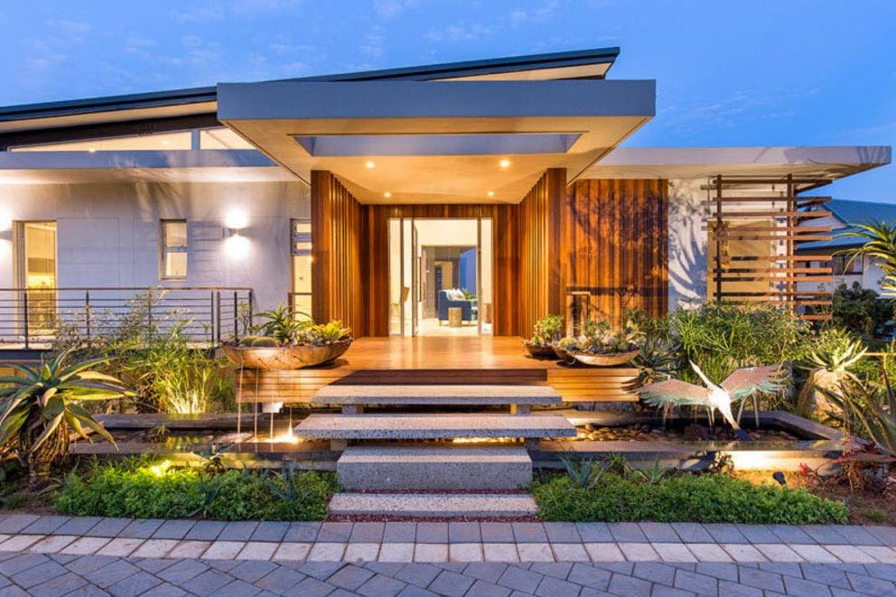 Dise o de fachada de casa moderna con fotos for Fachadas de casas interiores
