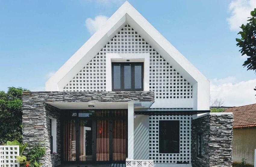 Dise o de peque a casa de dos pisos moderna armoniosa for Fachadas de piedra para casas pequenas