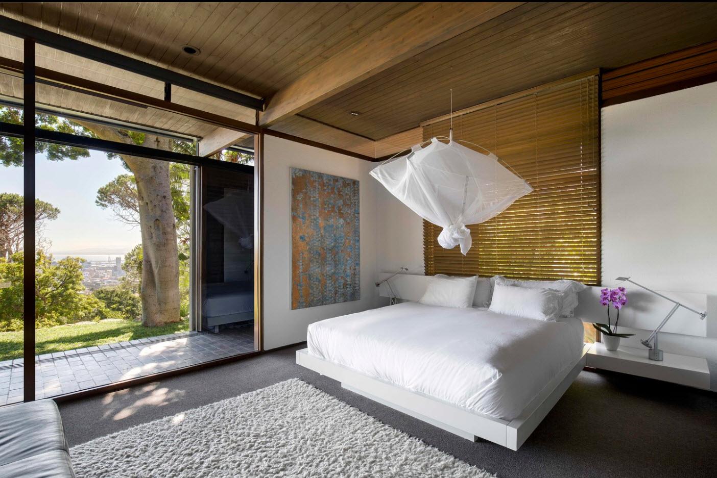 Diseño de dormitorio con vista a la ciudad
