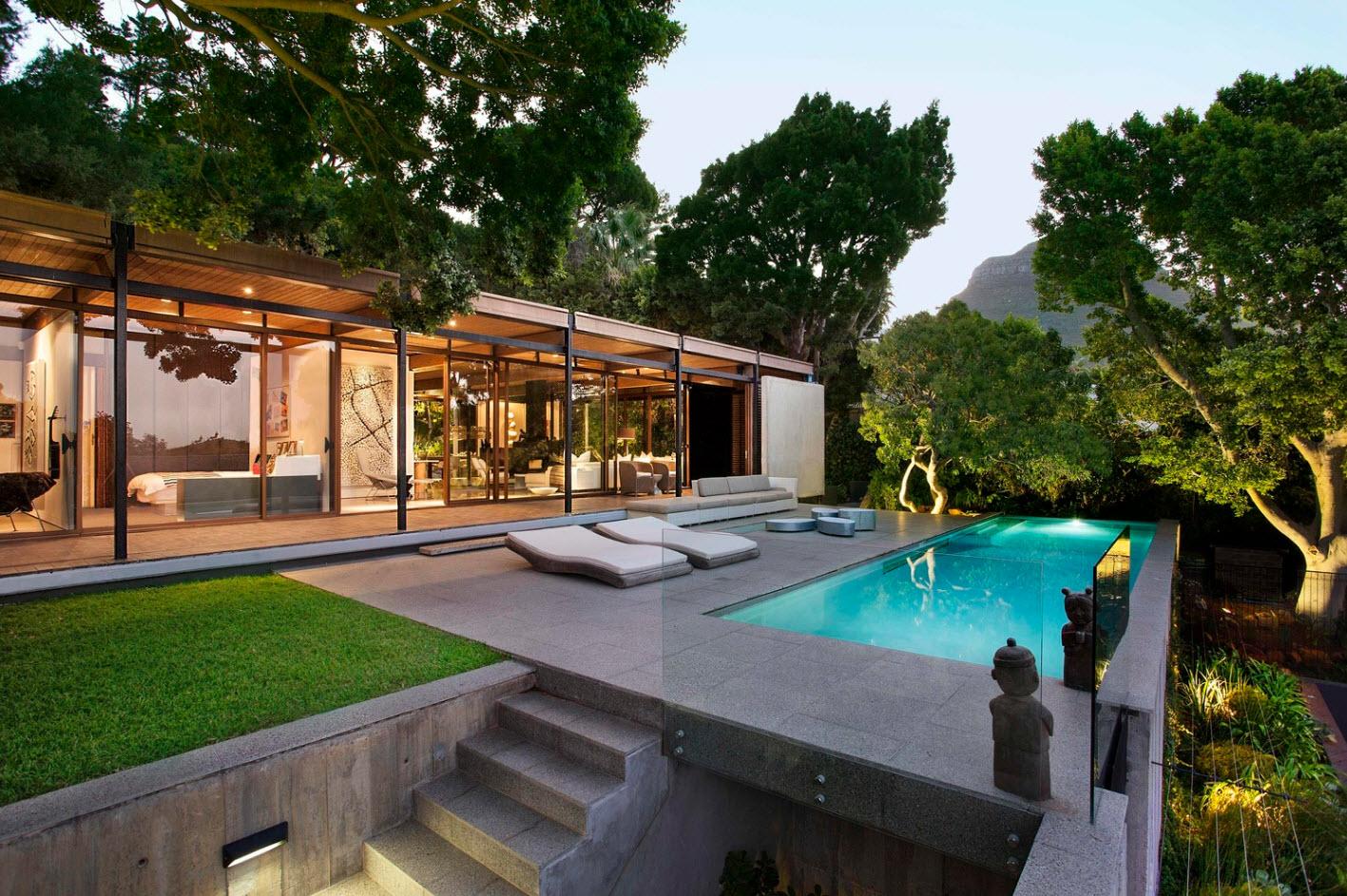 Dise o de moderna casa de monta a con impresionante vista for Casa de campo pequena con piscina