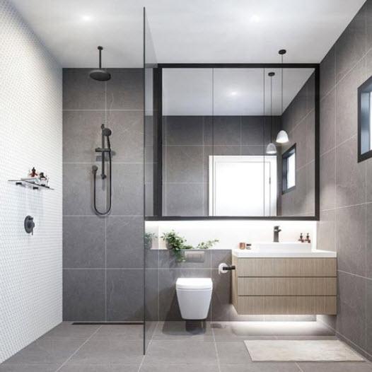 Baño pequeño con cerámica gris
