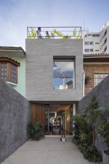 Fachada casa angosta dos pisos