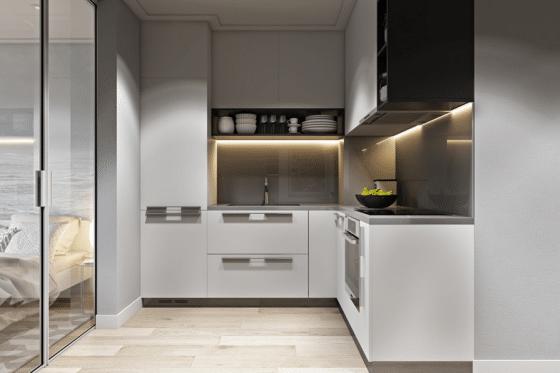 Pequeña cocina en forma de L y azulejos color gris