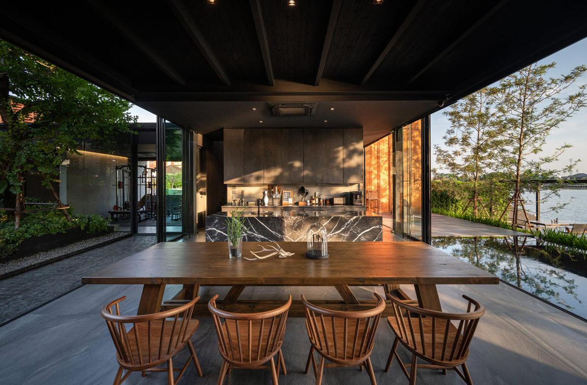 Diseño de comedor y cocina con vista hacia el paisaje natural