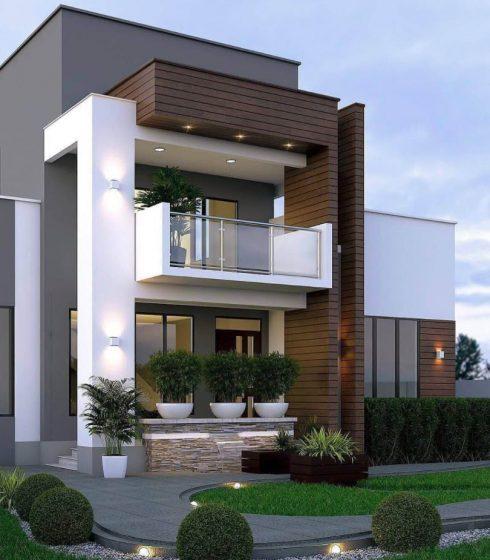 Elegante fachada de vivienda de dos pisos con elementos decorativos y plantas